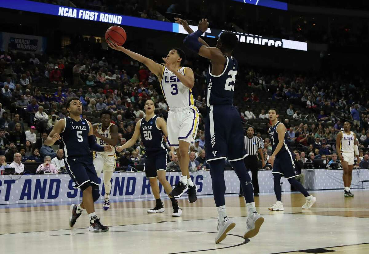 New Haven native Tremont Waters of LSU takes a shot against Yale's Miye Oni in the first half during the first round of the NCAA Tournament at VyStar Jacksonville Veterans Memorial Arena Thursday.