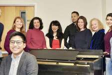 """Neil Flores, foreground, and Guy Stretton of Old Greenwich, left, join Stamford singers Rosa Parrotta, left, Lea Kessler Shaw, Pia Romano, Erick Sanchez-Canahuate, Brett Kroeger, Marian Shulman and Wendy Falconer onstage when Troupers Light Opera performs Gilbert and Sullivan's """"Ruddigore"""" April 6 and 13 in the Norwalk Concert Hall."""