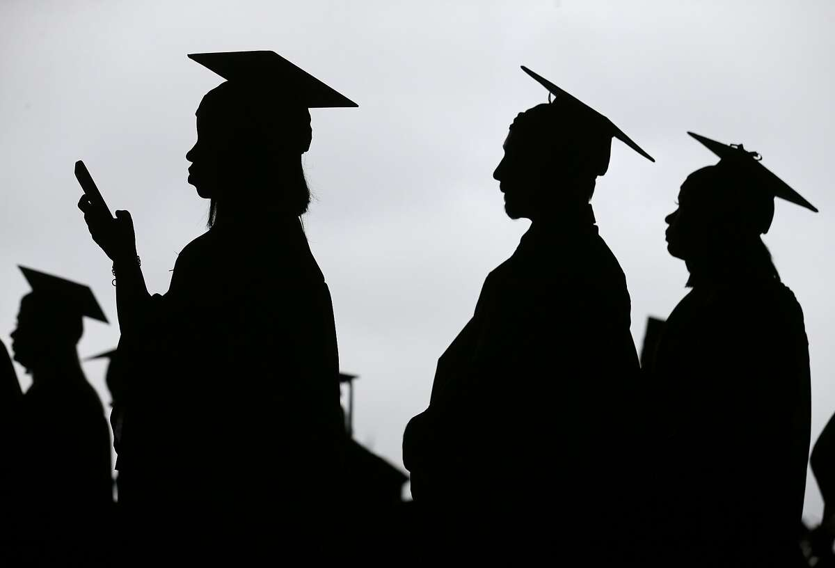 FILE- In this May 17, 2018, file photo, new graduates line up before the start of the Bergen Community College commencement at MetLife Stadium in East Rutherford, N.J. In high school, students hear that they should earn a college degree to have a well-paying, successful career. But student debt isn't good when your degree doesn't lead to a job that earns enough to repay it. (AP Photo/Seth Wenig, File)