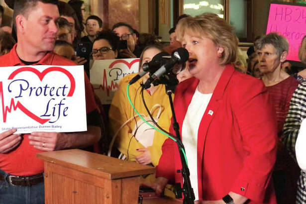 State Rep. Terri Bryant (R-Murphysboro) speaks during a protest Wednesday in the rotunda of the Capitol in Springfield against two abortion bills being considered by the General Assembly. Bryant urged everyone in attendance to fill out an electronic witness slip on the Illinois General Assembly's website in opposition to both pieces of legislation. She said she would request each of the thousands of names be read on the floor of the House.