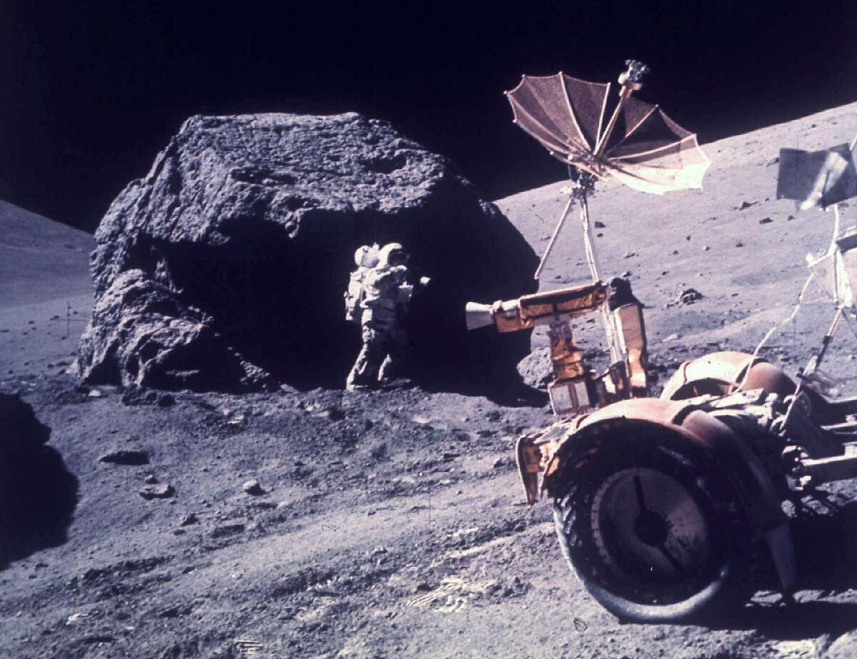 """** ADVANCE FOR SUNDAY, JUNE 30 **FILE **Astronaut Harrison H. Schmitt works beside a huge boulder during the third Apollo 17 extravehicular activity on the moon, Dec. 13, 1972. A piece of moon rock that was dug up during the Apollo 17 mission and flown back to Earth has become the center of litigation in a federal court in Florida. The 1.142-gram chunk of the moon could be worth millions on the open market. The last man to have it was asking $5 million. (AP Photo/NASA, File) HOUCHRON CAPTION (08/08/2002): Astronaut Harrison Schmitt works near a huge boulder on the surface of the moon during the Apollo 17 mission on Dec. 13, 1972. HOUCHRON CAPTION (12/06/2002): Apollo 17 astronaut Harrison """"Jack"""" Schmitt, a geologist, works beside a huge boulder on the surface of the moon."""