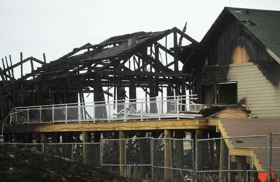 The charred, skeletal remains of the new concessions, bathrooms, and offices at Silver Sands State Park in Milford, Conn. on Wednesday, March 20, 2019. The new construction was completely destroyed in a fire late Tuesday night that was fully involved when firefighters arrived on scene. Photo: Brian A. Pounds / Hearst Connecticut Media / Connecticut Post