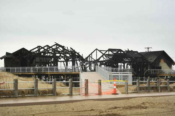 The charred, skeletal remains of the new concessions, bathrooms, and offices at Silver Sands State Park in Milford, Conn. on Wednesday, March 20, 2019. The new construction was completely destroyed in a fire late Tuesday night that was fully involved when firefighters arrived on scene.