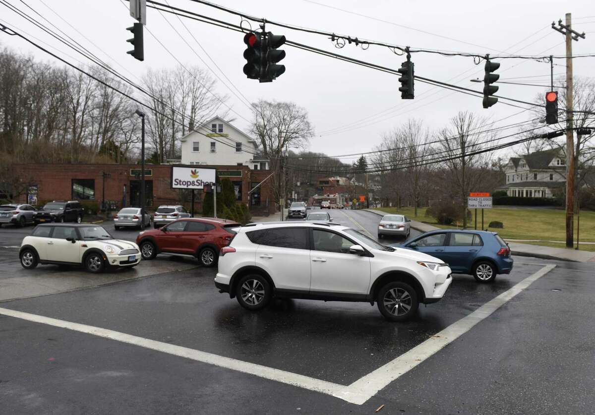 Traffic passes along Glenville Road near the intersection with Glen Ridge Road in the Glenville section of Greenwich, Conn. Thursday, March 21, 2019.