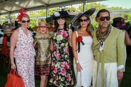 EMBARGOED FOR SOCIETY REPORTER UNTIL MARCH 22 Valerie Dieterich, from left, Diane Lokey Farb, Karen Payne, Varda Fields and Ceron at the Hermann Park Conservancy's annual Hats in the Park luncheon at Cherie Flores Garden Pavilion at McGovern Centennial Garden.