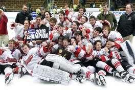 Fairfield Prep celebrates after defeating Notre Dame-West Haven 5-2 in the CIAC Division I ice hockey final at Ingalls Rink in New Haven on March 19, 2019.