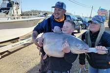 Brayden Rogers of Cisco hooked the massive blue catfish while fishing at Lake Tawakoni with Michael and Teri Littlejohn's Guide Service.