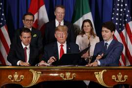 From left: President Enrique Peña Nieto of Mexico, President Donald Trump and Prime Minister Justin Trudeau of Canada sign a new free trade agreement, called the United States-Mexico-Canada Agreement, on the sidelines of the G-20 summit in Buenos Aires, Argentina, Nov. 30, 2018. Trump's ability to get the USMCA through Congress may hinge on a little-noticed provision governing intellectual property protections for new pharmaceutical products. (Tom Brenner/The New York Times)