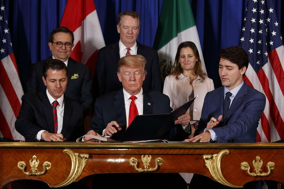 From left: President Enrique Peña Nieto of Mexico, President Donald Trump and Prime Minister Justin Trudeau of Canada sign a new free trade agreement, called the United States-Mexico-Canada Agreement, on the sidelines of the G-20 summit in Buenos Aires, Argentina, Nov. 30, 2018. Trump's ability to get the USMCA through Congress may hinge on a little-noticed provision governing intellectual property protections for new pharmaceutical products. (Tom Brenner/The New York Times) Photo: Tom Brenner, NYT