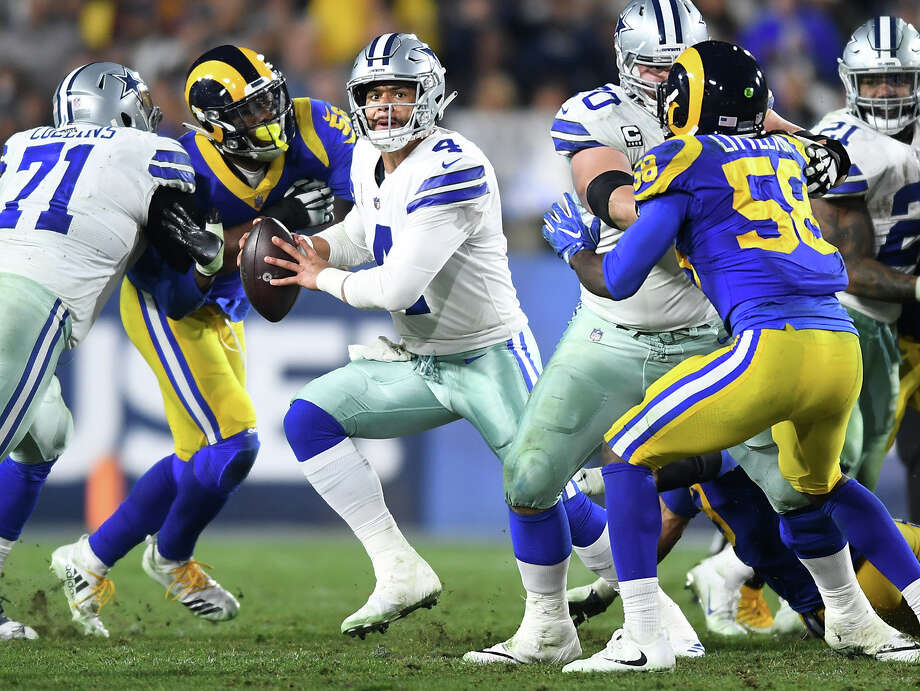 PHOTOS: NFL's best available free agents  Dallas Cowboys quarterback Dak Prescott (4) tries to escapes the Los Angeles Rams defense during the NFL Divisional Round at the Los Angeles Memorial Coliseum on Saturday, Jan. 12, 2019. The Rams advanced, 30-22.  >>>See which players remain available ...  Photo: Wally Skalij, TNS / Los Angeles Times
