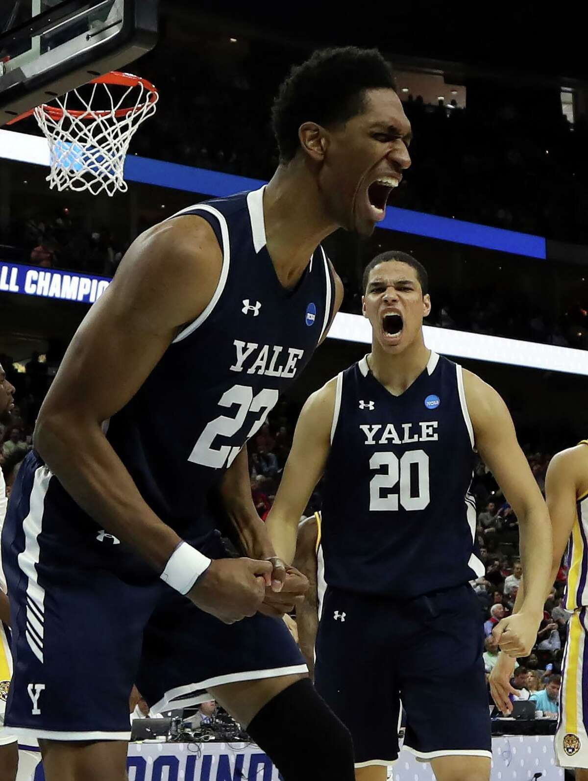 JACKSONVILLE, FLORIDA - MARCH 21: Jordan Bruner #23 and Paul Atkinson #20 of the Yale Bulldogs react in the second half of play against the LSU Tigers during the first round of the 2019 NCAA Men's Basketball Tournament at VyStar Jacksonville Veterans Memorial Arena on March 21, 2019 in Jacksonville, Florida. (Photo by Sam Greenwood/Getty Images)