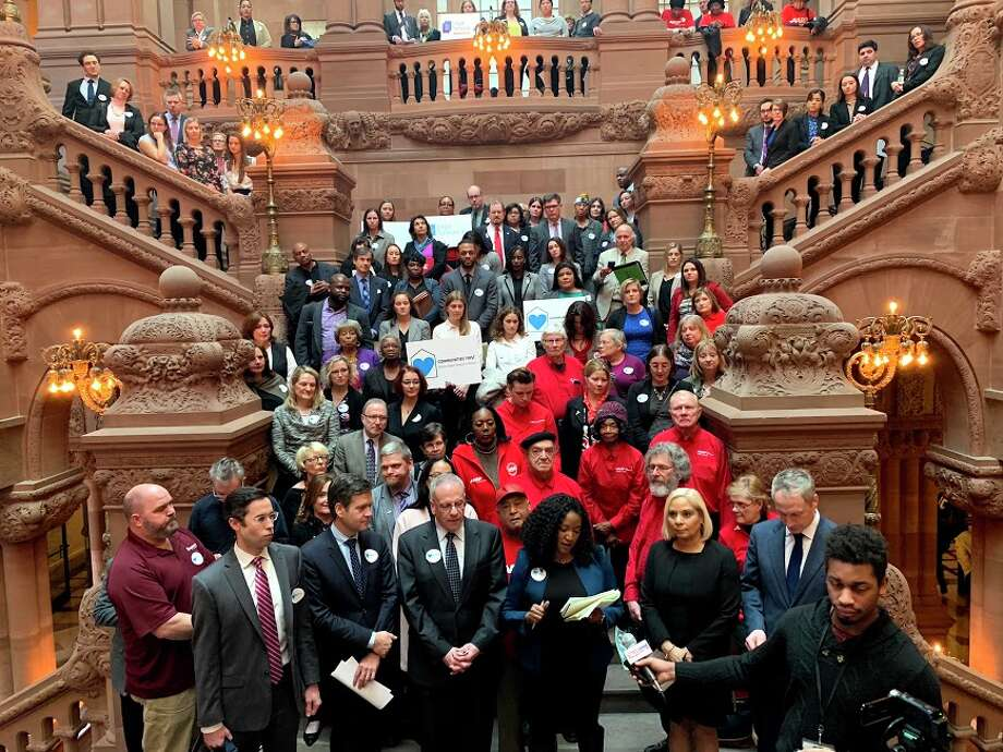 Activists and state lawmakers rally in February at Capitol for funding in the budget to pay for foreclosure prevention services. Photo: Communities First