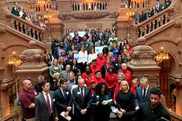 Activists and state lawmakers rally in February at Capitol for funding in the budget to pay for foreclosure prevention services.
