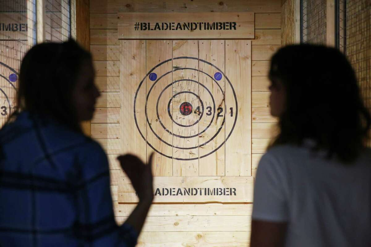 Communications director Jessie Poole goes over safety rules at the new axe throwing range opening in Capitol Hill this week, Blade and Timber. The Broadway spot will have throwing lanes available for public and private rental and will eventually serve food and drinks.