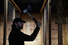 Company co-founder Ryan Henrich lines up a throw at his newest axe throwing range opening in Capitol Hill this week, Blade and Timber. The Broadway spot will have throwing lanes available for public and private rental and will eventually serve food and drinks. The company and Henrich are based out of Kansas City where their first venue opened in 2017.