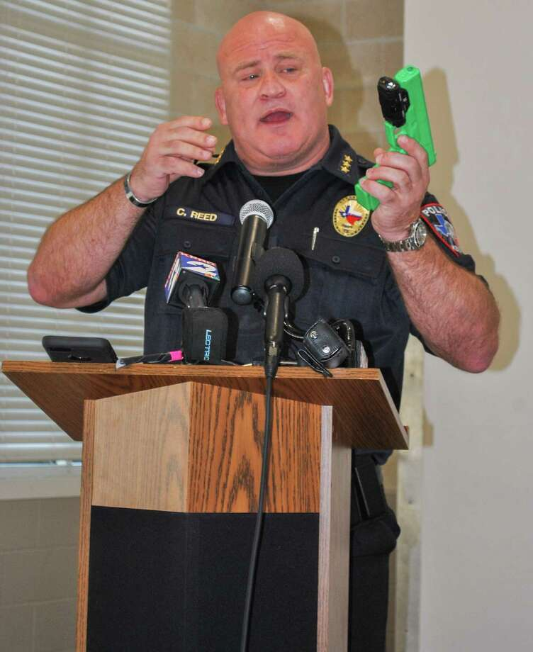 Kemah Police Chief Chris Reed gives a demonstration on how the handgun-mounted Fact Duty Camera works.