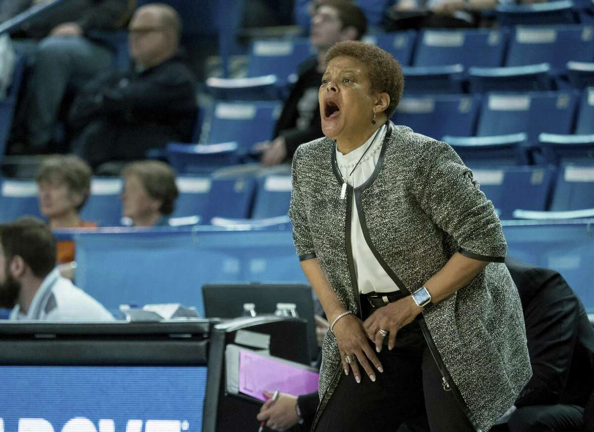 Towson head coach Diane Richardson shouts out to her players during the first half of an NCAA college basketball game against Drexel in the championship of the Colonial Athletic Association tournament, Saturday, March 16, 2019, in Newark, Del. (AP Photo/Suchat Pederson)