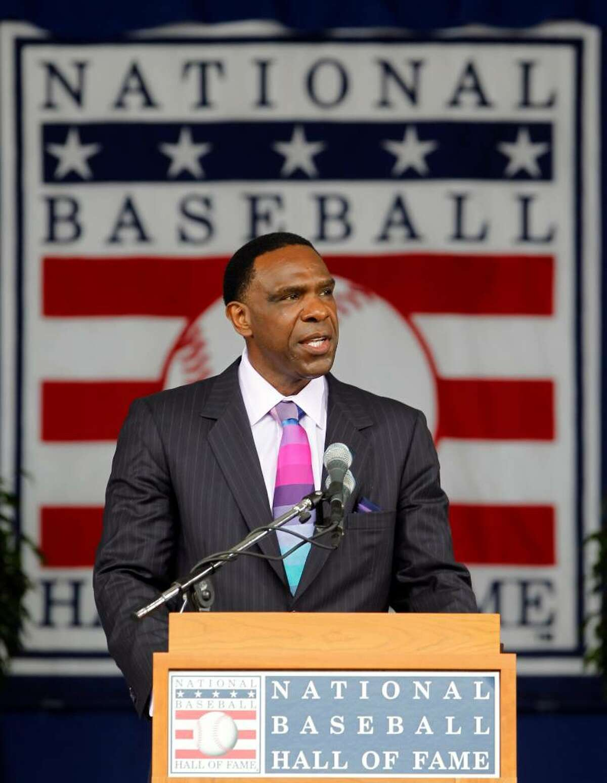 Andre Dawson delivers his Baseball Hall of Fame induction speech during a ceremony at the Clark Sports Center in Cooperstown, N.Y., on Sunday, July 25, 2010. (AP Photo/Mike Groll)
