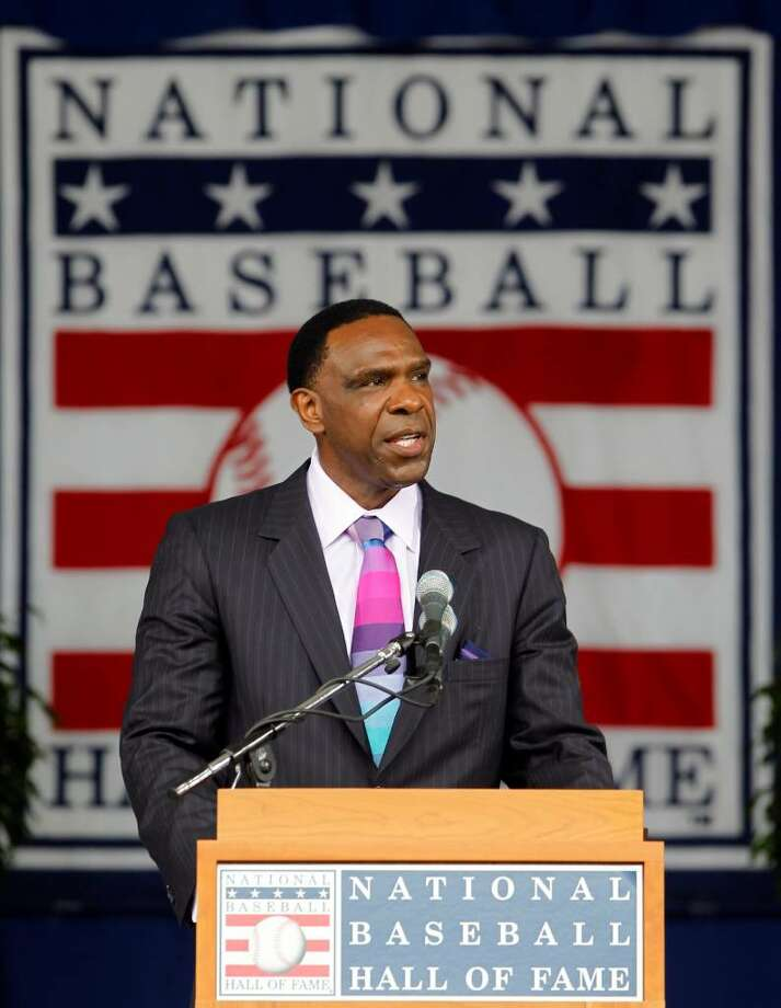 Andre Dawson delivers his Baseball Hall of Fame induction speech during a ceremony at the Clark Sports Center in Cooperstown, N.Y., on Sunday, July 25, 2010. (AP Photo/Mike Groll) Photo: AP