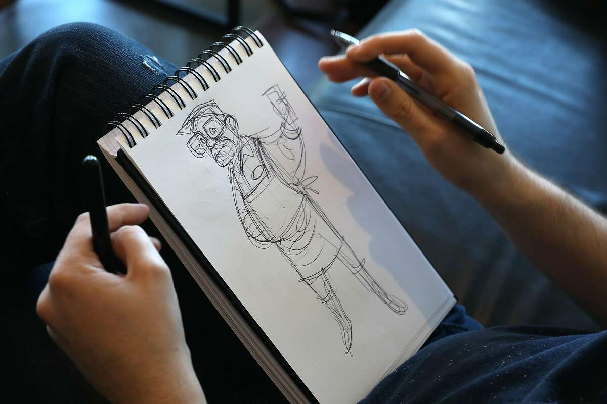 Illustrator Jeff Lance works on sketches while having coffee at Precita Park Cafe on Thursday, March 14, 2019, in San Francisco, Calif. He had an appendectomy at S.F. General trauma hospital costing him 58,000$ dollars.