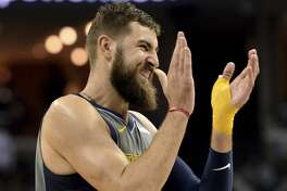 Memphis Grizzlies center Jonas Valanciunas applauds during the second half of the team's NBA basketball game against the Houston Rockets Wednesday, March 20, 2019, in Memphis, Tenn. The Grizzlies won 126-125 in overtime. (AP Photo/Brandon Dill)