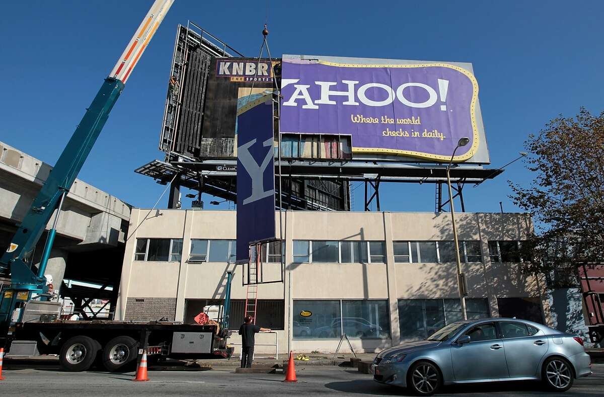 Workers use a crane to move a section of a Yahoo! billboard on December 21, 2011 in San Francisco, California. Yahoo's iconic retro-style billboard was taken down after 12 years of greeting visitors to San Francisco. The brightly colored billboard, reminiscent of a 1960's era motel sign, was installed in 1999 next to Interstate 80 near downtown San Francisco.