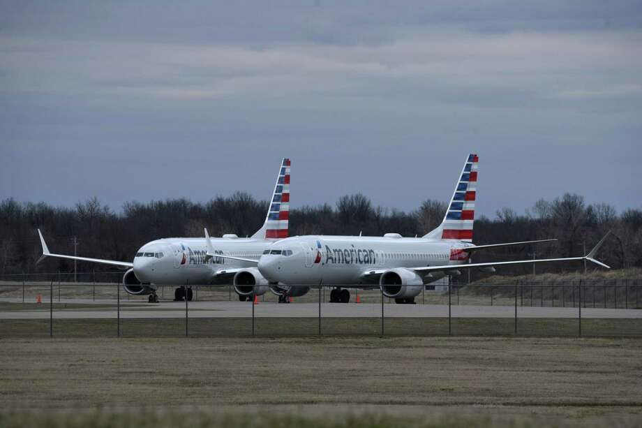 A pair of Boeing 737 Max 8 aircraft sit near an American Airlines maintenance hangar at Tulsa International Airport in Oklahoma, March 14. Following two deadly crashes, the U.S. was tardy in grounding the aircraft though many nations already had. Photo: NICK OXFORD /NYT / NYTNS