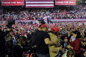 A man is restrained after he shoved members of the media during a rally for President Donald Trump in El Paso last month. As Trump and his supporters push the notion of the political end times, normal governing tools — civility, persuasion, skill — are cast aside.