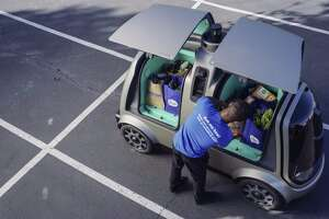 This undated image provided by The Kroger Co. shows an autonomous vehicle called the R1. Nuro and grocery chain Kroger are teaming up to bring unmanned delivery service to customers. The companies said Tuesday, Dec. 18, 2018, that Nuro's unmanned vehicle, the R1, will be added to a fleet of autonomous Prius vehicles that have run self-driving grocery delivery service in Scottsdale, Ariz., with vehicle operators since August. (The Kroger Co. via AP)