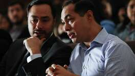 BELL GARDENS, CALIFORNIA - MARCH 04: Democratic presidential candidate Julian Castro (R) and his twin brother U.S. Rep. Joaquin Castro (D-TX) sit at a campaign appearance at Bell Gardens High School, in Los Angeles county, on March 4, 2019 in Bell Gardens, California. Castro, who served as Secretary of Housing and Urban Development (HUD) under President Barack Obama, is aiming to become the country's first Latino president. (Photo by Mario Tama/Getty Images)
