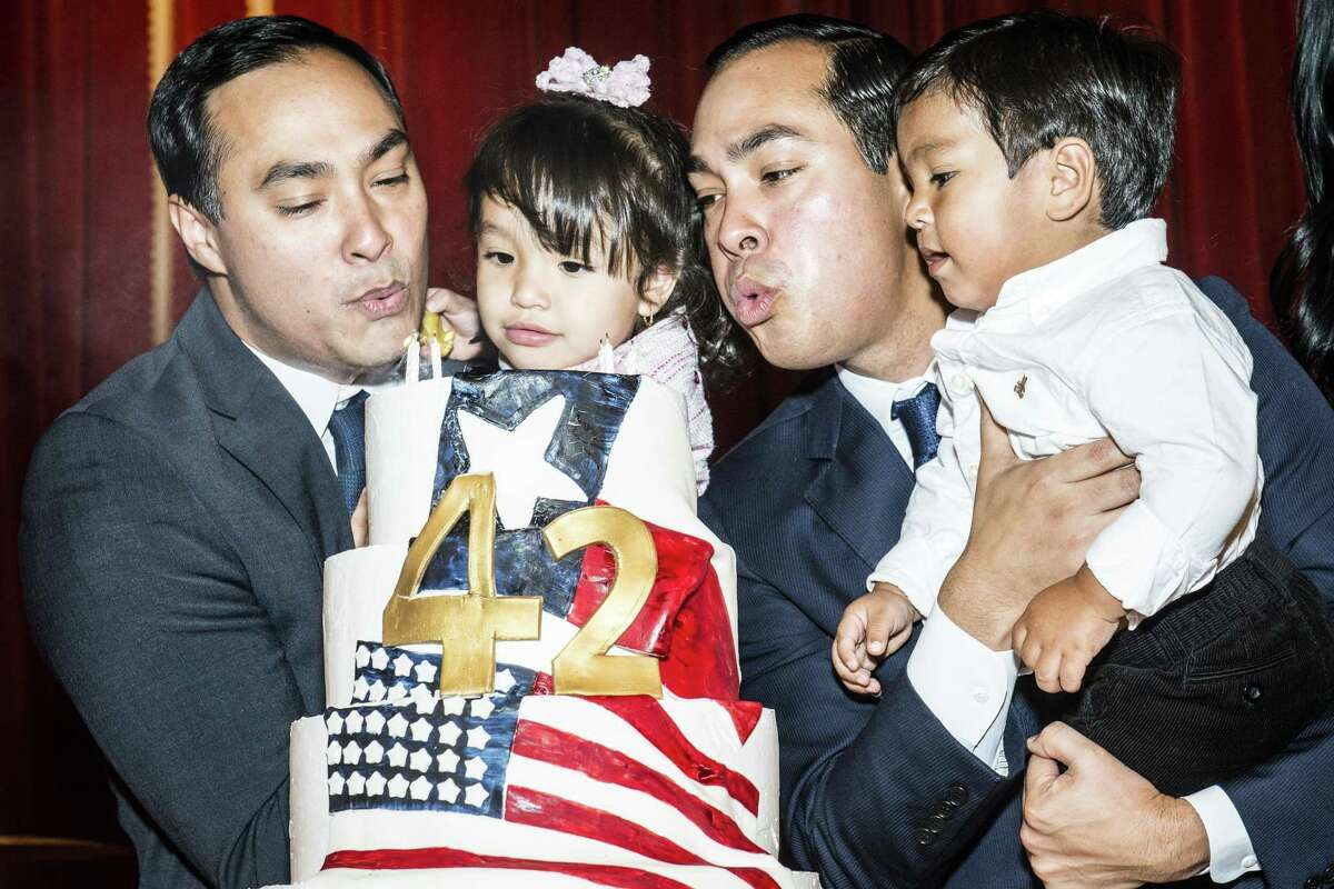 Brothers Joaquin, left, and Julian Castro, right blow out their birthday cake while holding their children, Andrea Elena Castro and Cristi‡n Juli‡n Castro, respectively during their birthday party on Friday, September 16, 2016 in San Antonio, Texas. Joaquin Castro is a Democratic U.S. Representative for Texas' 20th district and Julian Castro is the U.S. Secretary for Housing and Urban Development. The twin brothers celebrated their 42nd birthday.