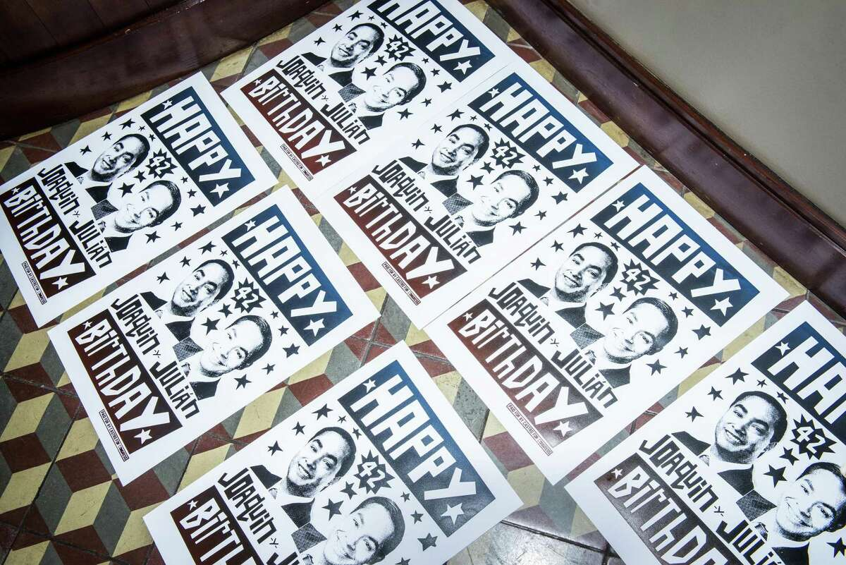Posters are laid out to dry during a birthday party for brothers Joaquin and Julian Castro on Friday, September 16, 2016 in San Antonio, Texas. Joaquin Castro is a Democratic U.S. Representative for Texas' 20th district and Julian Castro is the U.S. Secretary for Housing and Urban Development. The twin brothers celebrated their 42nd birthday.