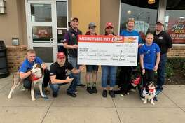 Raising Cane's recently presented a check to Sweetpups Dog Rescue & Sanctuary in Vidor for $1,537.61.