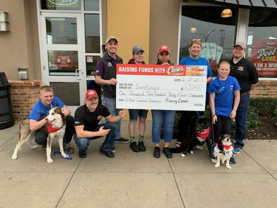 Raising Cane's recently presented a check to Sweetpups Dog Rescue & Sanctuary in Vidor for $1,537.61. Photo: Provided By Raising Cane's
