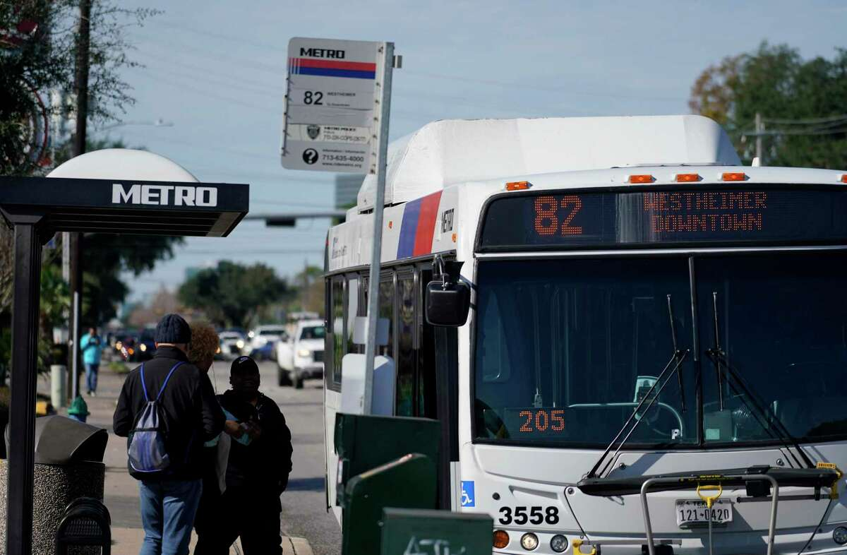 People wait to board a Metro Route 82 bus on Westheimer near Gessner Wednesday, Jan. 9, 2019, in Houston.
