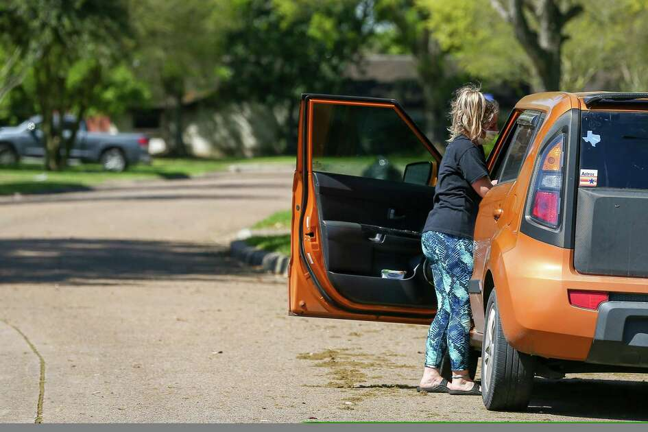 Deer Park native Katy Powers,17, wears a mask while loading into her car as the city was under a shelter-in-place Thursday, March 21, 2019, in Deer Park, Texas.