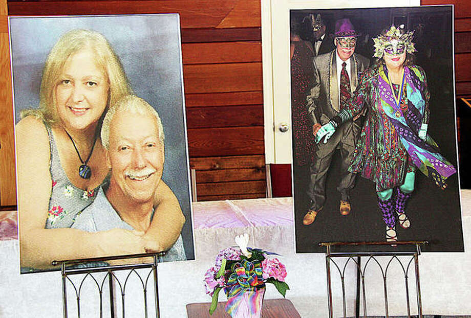 Mike and Lois Ladd were immortalized in these oversized photographs, which were displayed at the Edwardsville Rotary Club Thursday at the First Christian Church. Various Rotarians remembered the couple with stories and anecdotes. Photo: Photos By Charles Bolinger | The Intelligencer