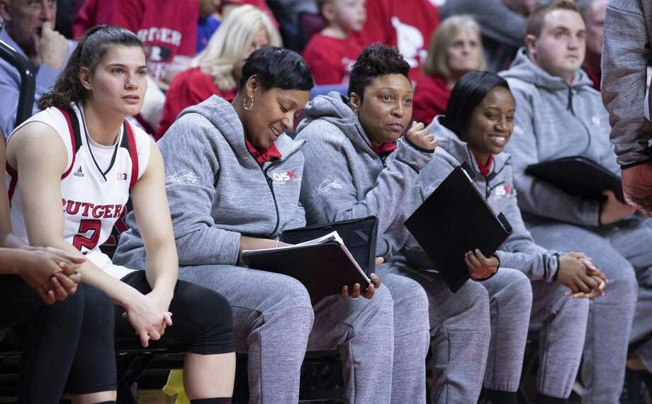 Rutgers assistant women's basketball coach Nadine Domond, third from left, was a former star at Bridgeport Central. Photo: Ben Solomon / Rutgers Athletics / Stamford Advocate Contributed