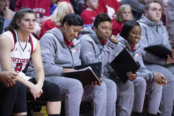 Rutgers assistant women's basketball coach Nadine Domond, third from left, was a former star at Bridgeport Central.