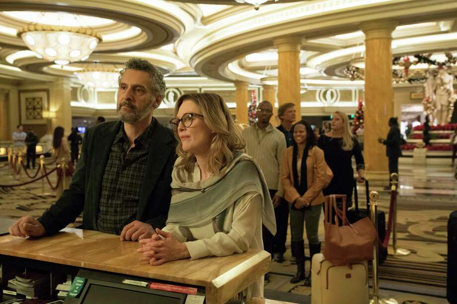 "This image released by A24 shows John Torturro and Julianne Moore in a scene from ""Gloria Bell."" Everyone is vanishing around Julianne Moore's title character in Sebastian Lelio's ""Gloria Bell."" The disappearances don?t come with blood-curdling shrieks or thundering score cues, but with the humdrum ebb of middle age. People just move away or recede from view. (A24 via AP) Photo: Hilary Bronwyn Gayle / A24This image released by A24 shows Julianne Moore in a scene from ""Gloria Bell."" (A24 via AP)"