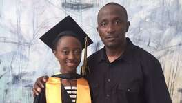 Omega McKinnon on graduation day with her father Anthony Scott.