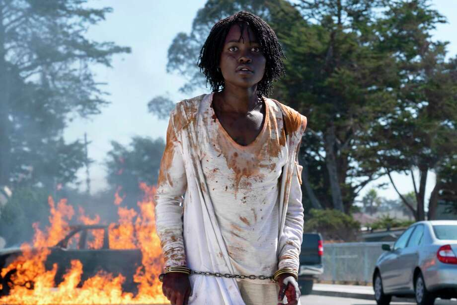 """This image released by Universal Pictures shows Lupita Nyong'o in a scene from """"Us,"""" written, produced and directed by Jordan Peele. (Claudette Barius/Universal Pictures via AP) Photo: Claudette Barius / © Universal Pictures"""