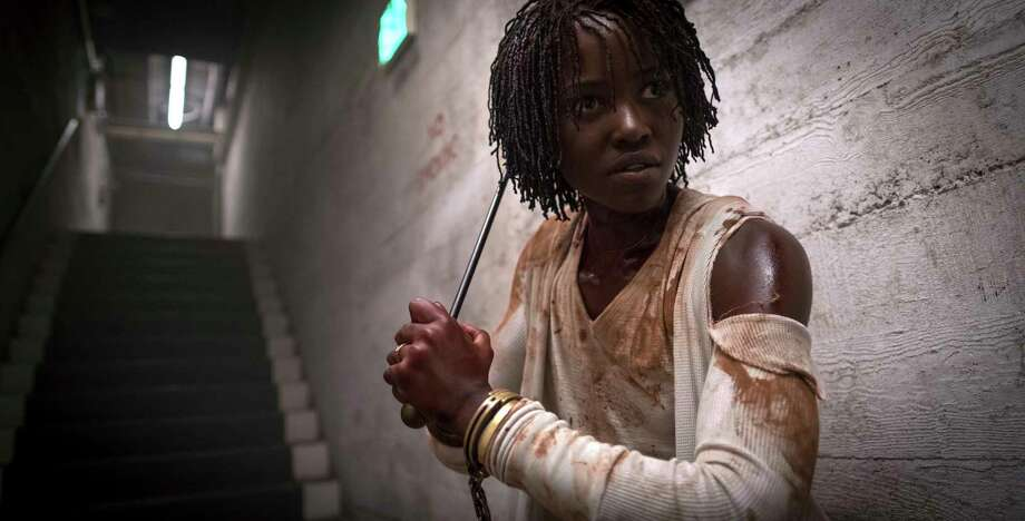 "This image released by Universal Pictures shows Lupita Nyong'o in a scene from ""Us,"" written, produced and directed by Jordan Peele. The film, based in Santa Cruz, has scared some of the people who have seen it away from the California beach town.