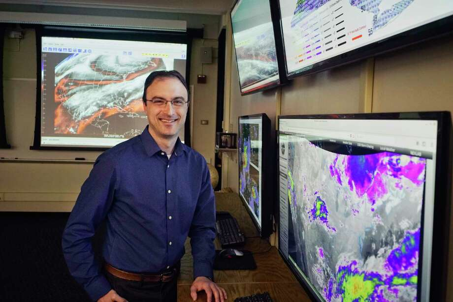 Ross Lazear, an instructor in the UAlbany department of Atmospheric and Environmental Sciences, poses for a photo in the weather map room at the college on Tuesday, March 19, 2019, in Albany, N.Y.  (Paul Buckowski/Times Union) Photo: Paul Buckowski / (Paul Buckowski/Times Union)