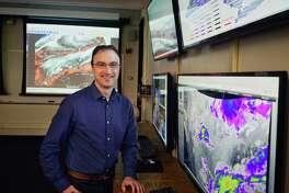 Ross Lazear, an instructor in the UAlbany department of Atmospheric and Environmental Sciences, poses for a photo in the weather map room at the college on Tuesday, March 19, 2019, in Albany, N.Y. (Paul Buckowski/Times Union)