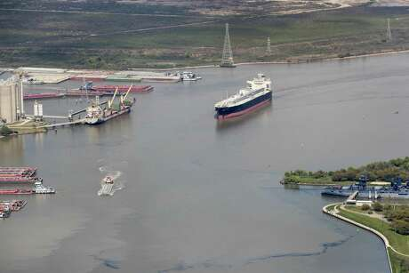 Maritime traffic moves through the Houston Ship Chanel past the site of now-extinguished petrochemical tank fire at Intercontinental Terminals Company on Wednesday, March 20, 2019, in Deer Park. Air quality and water pollution from the fire's runoff into the ship channel are some of the concerns in the aftermath of the blaze.