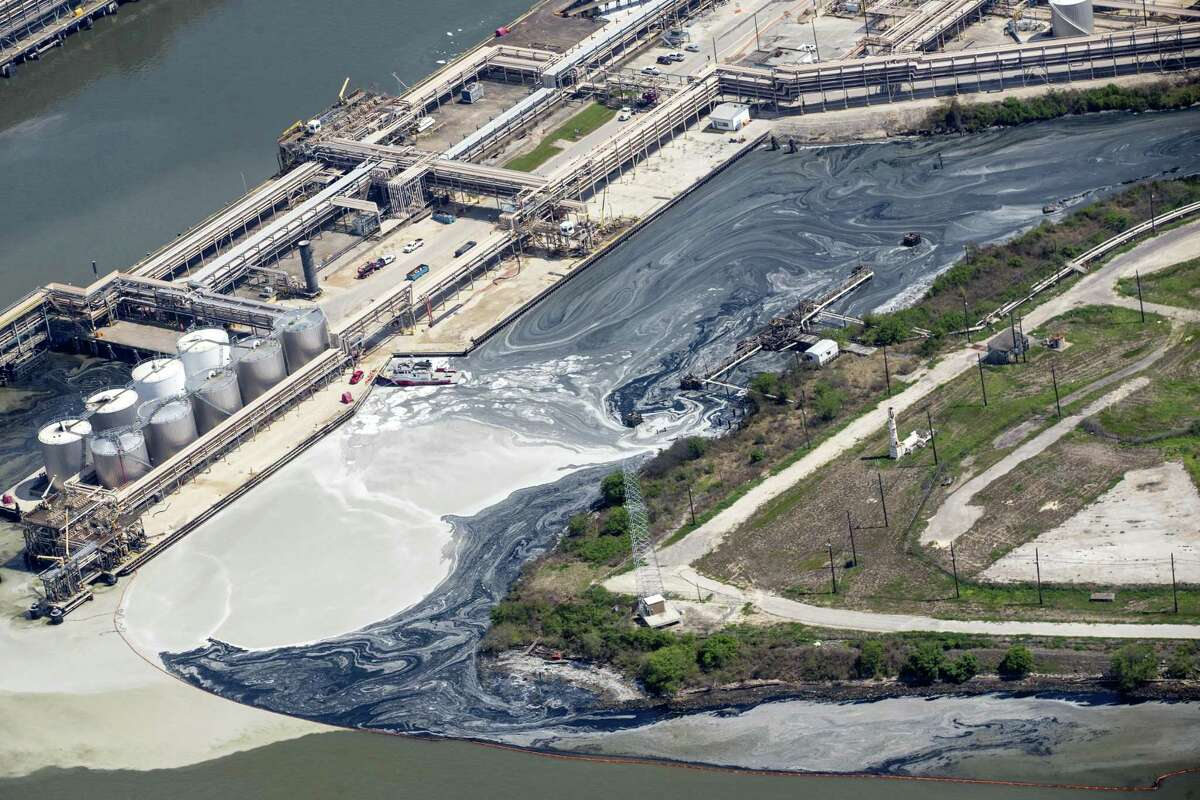 Runoff from the now-extinguished petrochemical tank fire at Intercontinental Terminals Company is blocked by an oil skimming bouy on Wednesday, March 20, 2019, in Deer Park. The Harris County District Attorney's office this week charged the company with five counts of water pollution.