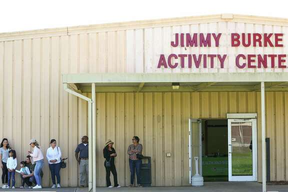 People wait in line to receive medical attention at Harris County Public Health's mobile clinic set up at the Jimmy Burke Activity Center Thursday, March 21, 2019, in Deer Park, Texas. The city was ordered to shelter-in-place earlier today due to elevated levels of benzene.