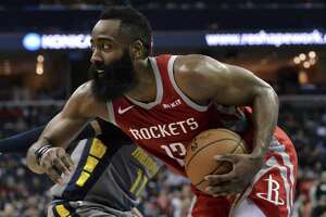 Houston Rockets guard James Harden (13) handles the ball in the second half of an NBA basketball game against the Memphis Grizzlies Wednesday, March 20, 2019, in Memphis, Tenn. (AP Photo/Brandon Dill)