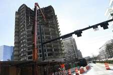 Traffic is redirected as crews demolish St. John's Tower in Stamford, Conn. Sunday, Jan. 13, 2019. The northbound lane of Washington Boulevard was closed as crews worked from Friday night through early Monday. Work will halt during the week and pick up again next Friday night.